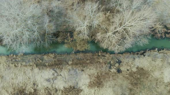 Thumbnail for Aerial top view of narrow dirty river. Polluted river full of dirty water. Environmental problems