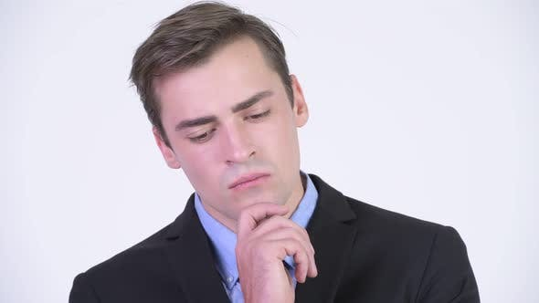 Cover Image for Young Serious Businessman Thinking While Looking Down