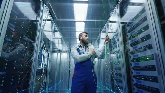 Thumbnail for Male Technician Working in a Data Center