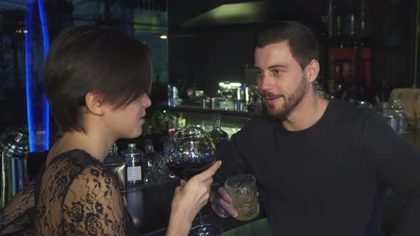 Thumbnail for Happy Young Loving Couple Enjoying Drinks Togather at the Local Restaurant Bar