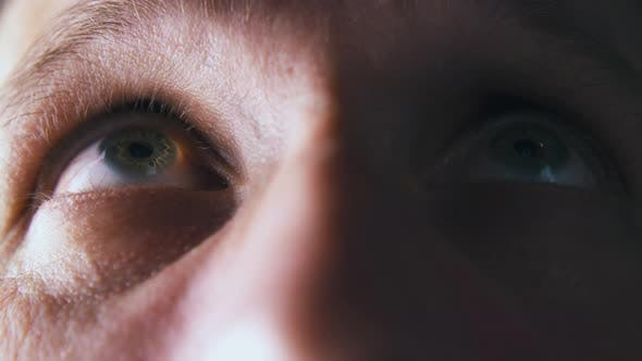 Thumbnail for Person Looks Up and Straight with Green Eye in Shadow