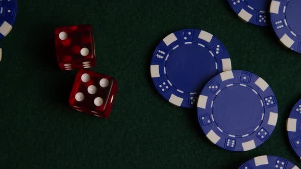 Rotating shot of poker cards and poker chips on a green felt surface - POKER 022