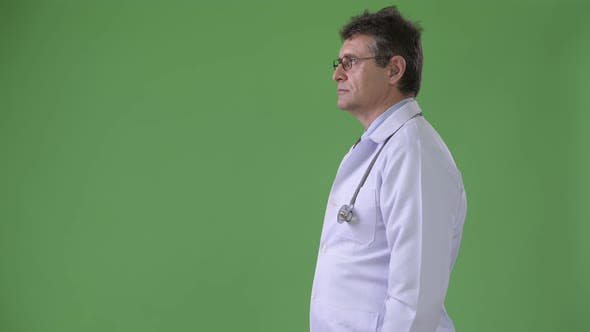 Thumbnail for Mature Handsome Man Doctor Against Green Background