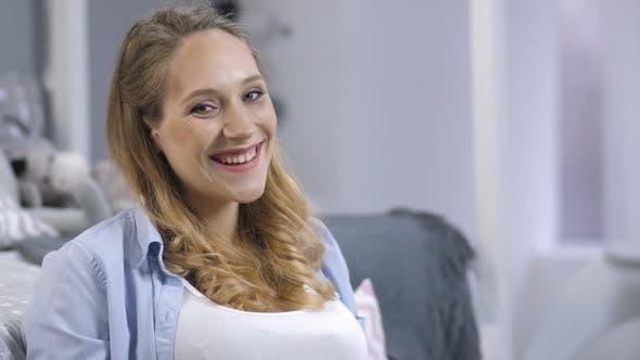 Thumbnail for Playful Pregnant Woman Smiling at Camera