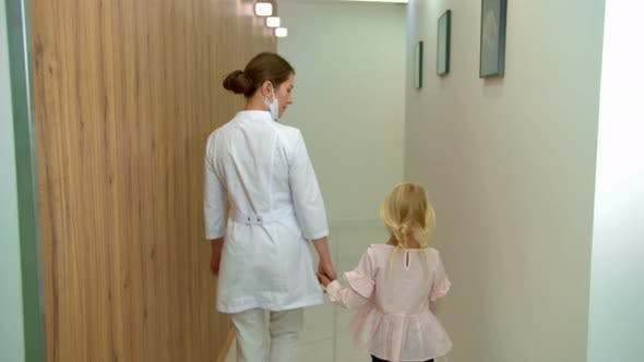 Cover Image for Doctor Walks with Girl Along the Corridor
