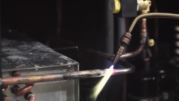Thumbnail for Close Up On Blow Torch Fusing Copper Tube Together With Solder