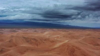 Aerial View on Sand Dunes with Storm Clouds