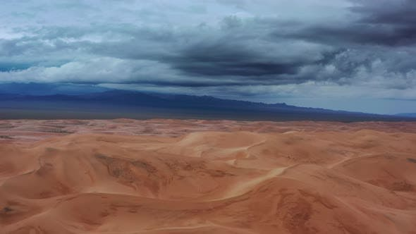 Thumbnail for Aerial View on Sand Dunes with Storm Clouds