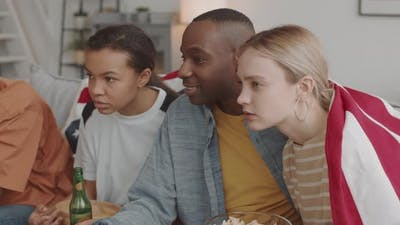 Young People Watching TV Carefully