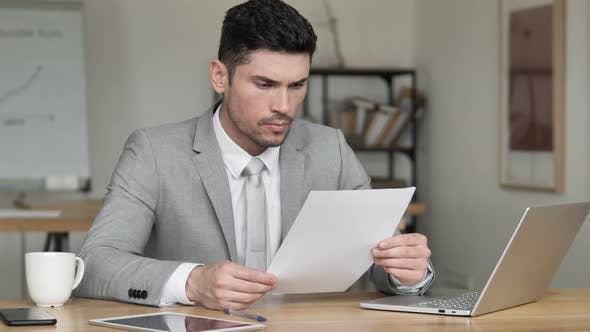 Thumbnail for Businessman Reading Documents, Contract