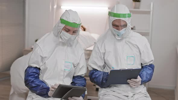 Doctors In Protective Suits Working