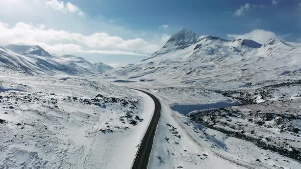 Thumbnail for Road in the Mountains in Winter in Iceland. Winter Road Trip.