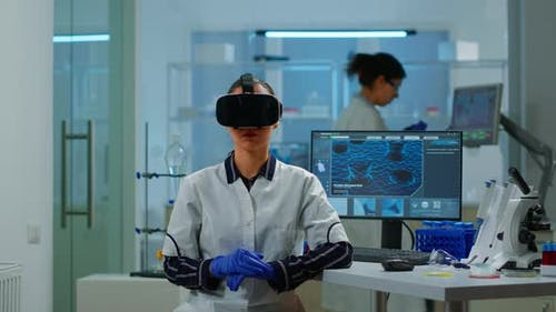 Laboratory Doctor Experiencing Virtual Reality Using Vr Goggles