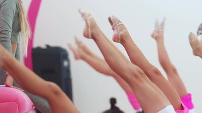 A Bunch of Little Girls Training Their Legs on Gymnastic Training