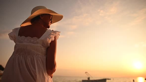 Woman Enjoying Retirement Vacation on the Beach