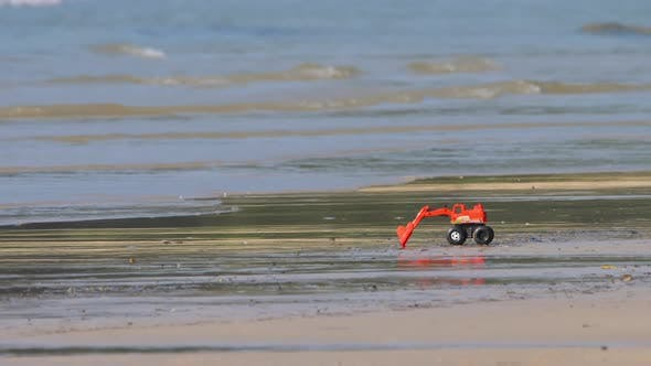Thumbnail for Toy Excavator on the Sandy Beach
