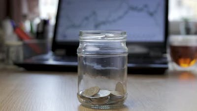Timelapse of Money Coin in Glass Jar Growing Money