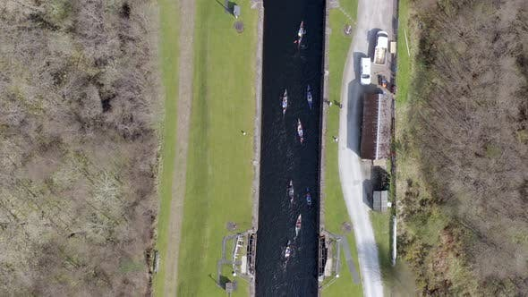 Thumbnail for A Large Group of Canoeists Traversing a Canal Lock