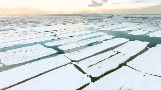 Thumbnail for Aerial view of marshland covered with snow in The Netherlands.