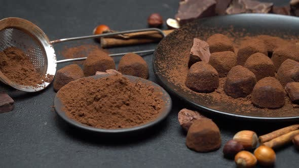 Thumbnail for Chocolate Truffles Candies, Chocolate Pieces and Cocoa Powder on Dark Concrete Background