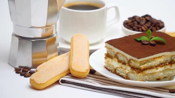 Tiramisu Portion, Mocha Coffee Maker, Savoiardi Cookies and Cup of Coffee on White Background