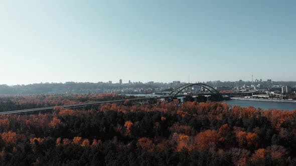 Thumbnail for Aerial View of Kiev City Park, River and Bridge with Buildings on Background