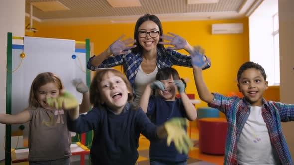 Diverse Kids Showing Hands Painted with Paint