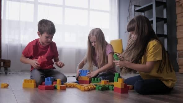 Thumbnail for Joyful Children Play Educational Games, Build Toys From Colored Blocks of Designer