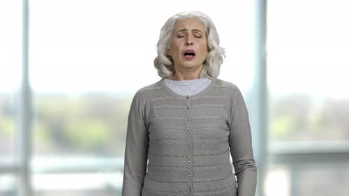 Old Woman Sneezing with an Handkerchief