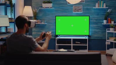 Man with Green Screen Background Display Using Vr Glasses