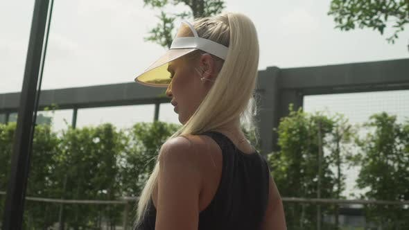 Beautiful Blonde Tennis Player Getting Ready to Serve