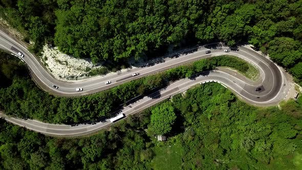 Thumbnail for Top Down View From Above View of a Curved Winding Road Trough the Mountains