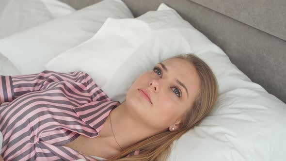 Thumbnail for Attractive Girl with Beautiful Blue Eyes Crying in Bedroom.