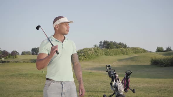 Thumbnail for Portrait Cute Smiling Confident Successful Middle Eastern Man with a Golf Club Standing on a Golf