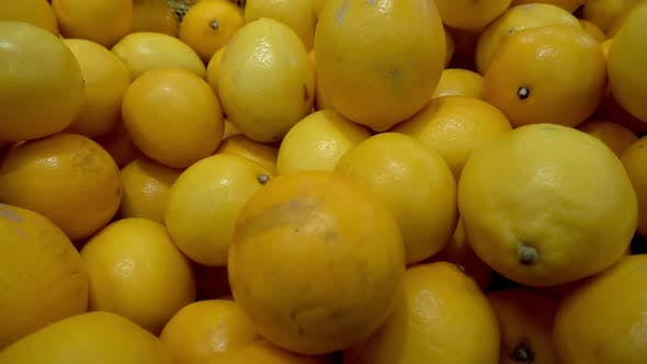 Thumbnail for Pile Of Yellow Lemons On The Market Counter