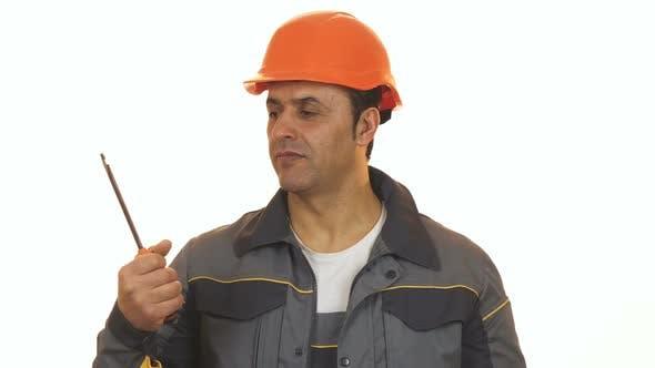 Thumbnail for Mature Repairman Choosing Between Screwdriver and Drilling Machine