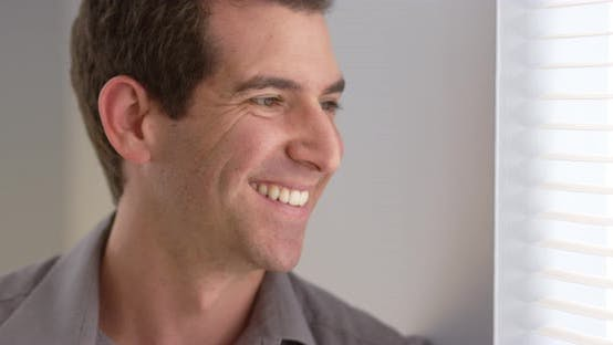 Cover Image for Close up of happy businessman looking at camera