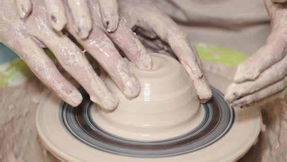 Thumbnail for Couple Hands Making a Pot on a Pottery Workshop