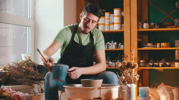 Thumbnail for Pottery - the Master Is Putting Down a Bucket of Paint and Wiping Sweat From His Forehead