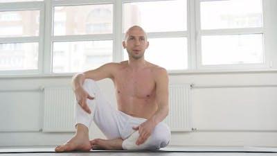 Shirtless Yogi Male Having Rest After Yoga Exercises