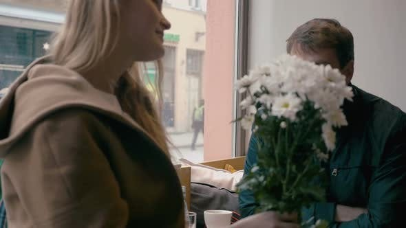 Loving couple looking at each other in cafe