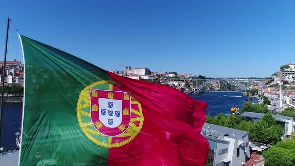 Thumbnail for Portugal Flag With City of Porto in the Background