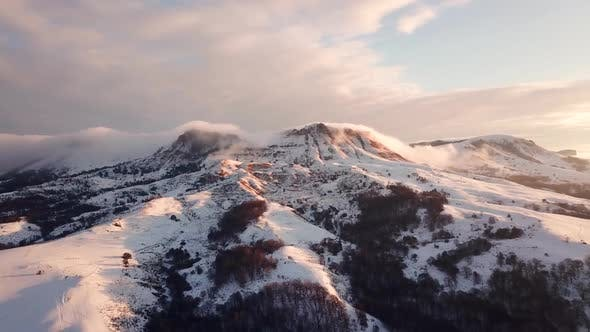 Thumbnail for Idyllic Landscape Snow Covered Mountains Drone Footage Winter Nature