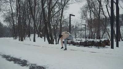 Man Exercising in Snow Covered Park