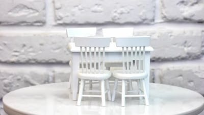 Furniture for dolls and dollhouse. Close up of toy wooden furniture, rotation