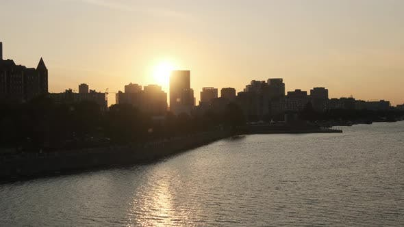 Thumbnail for Sunset Over Embankment of Big City with Silhouettes of Multi-storey Buildings