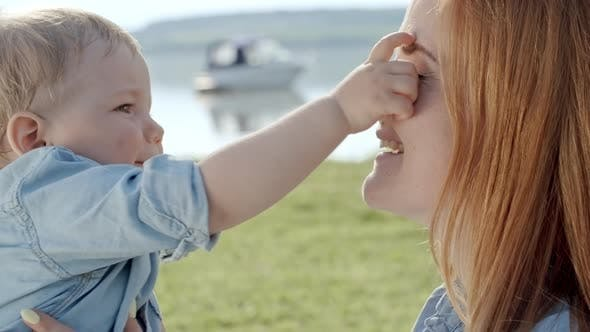 Thumbnail for Cute Toddler and Mother Playing