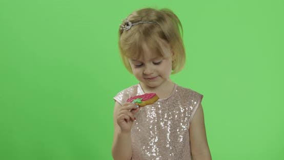 Thumbnail for Girl in Glossy Dress Begins To Eat Cookies in the Form of Strawberries