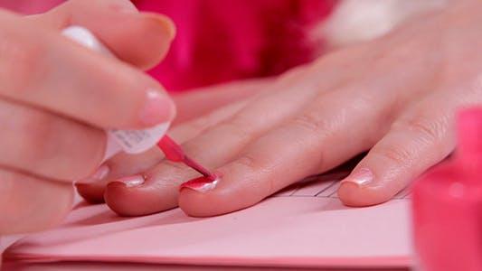 Thumbnail for Woman Paints Pink Nail Polish
