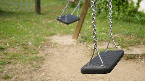 Empty Swings Swinging